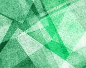 abstract green background with white parchment paper geometric shapes