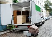 stock photo of moving van  - house move van with furniture and tools - JPG