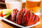 picture of southern fried chicken  - grilled chicken wings with vegetables and beer