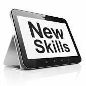 Education concept: New Skills on tablet pc computer