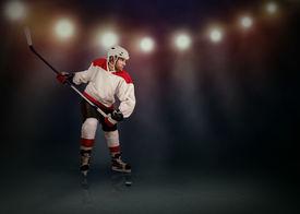 stock photo of olympiade  - Ice Hockey player ready to make a slapshot - JPG