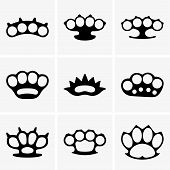 picture of brass knuckles  - Set of nine brass knuckles on grey background - JPG