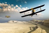 Vintage WWI Double wing planes flying over canyon