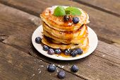 Delicious pancakes with blueberry and mint