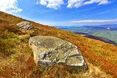 Old stones on slopes of Carpathian mountains