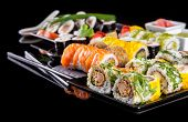 picture of dragon-fish  - Various kind of sushi food served on black background - JPG