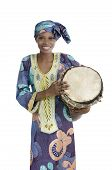 stock photo of kaba  - Traditional african woman with djembe drum Studio Shot - JPG