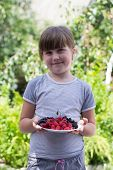 Little Girl With Berries In Hands