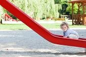 Little Boy On Slide