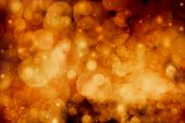 Abstract festive orange bokeh background