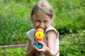 Small Girl With Toy Water Gun