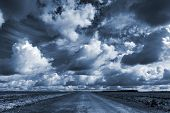 picture of road trip  - Empty asphalt country road under dark dramatic cloudy sky - JPG