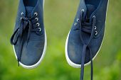 Dirty Blue Sneakers On Clothes Line