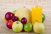 variety of fruits and a juice at the kitchen