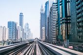 DUBAI, UAE - MARCH 31: Metro line in Dubai on March 31, 2014, UAE. The Dubai Metro is a driverless,