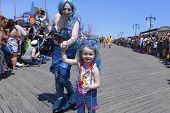 Little girl in costume with mom on boardwalk