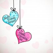 Hanging colorful hearts with stylish text Happy Friendship Day on grey background.