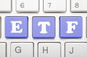 Blue exchange traded fund key on keyboard