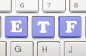 Blue exchange traded fund key on keyboard