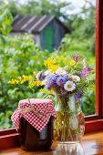 Bunch Of Garden Flowers And Jam
