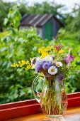 Bouquet Of Summer Flowers And Healing Herbs In Jug