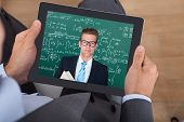 Businessman Attending Online Math's Lecture On Digital Tablet