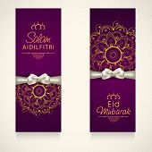 Beautiful floral decorated banner design with silver ribbon for Muslim community festival Eid Mubarak celebrations.