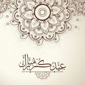 Arabic Islamic calligraphy of text Eid Mubarak on floral decorated on beige background for Muslim co