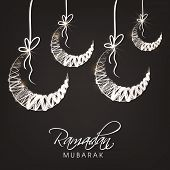 Hanging moon on black background for holy month of Muslim community Ramadan Mubarak.