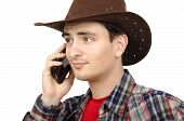 Puzzled  Cowboy Talking On Smartphone