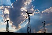 Windmills Against Blue Sky And Clouds