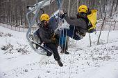 SOCHI, RUSSIA - DECEMBER 12, 2013: Rescuers rehearse rescue on the ski lift. Mountain resort