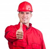 Young smiling construction worker with hard hat and in full uniform