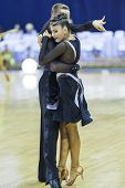Minsk-belarus, October 4,2014: Unidentified Professional Dance Couple Performs Youth-2 Latin-america