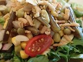 Salad With Spring Lettuce, Grape Tomatoes, Nuts, Peas, Corn, And Onions.