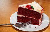 picture of red velvet cake  - Red velvet cake on a white plate with a fork - JPG