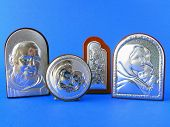 stock photo of pio  - Different religious silver plated icons over blue