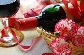 stock photo of carnation  - red wine for celebration with carnation flowers - JPG