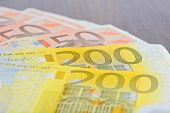 Close-up of 200 and 50 Euro banknotes on the table