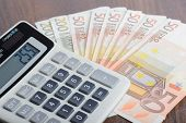 Calculator and banknotes on the table