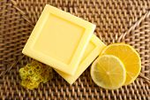 Bars of natural soap on wicker mat background