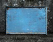 Old Blue Blank Weathered Wooden Board On Dark Mottled Background