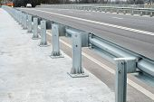 stock photo of safety barrier  - Anodized safety steel barrier on freeway bridge - JPG