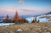 Evening in mountains. Spring landscape with last snow