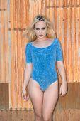 stock photo of bodysuit  - Pretty petite blonde in a blue bodysuit - JPG
