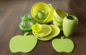 green dishes on a dark wood floor