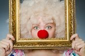 foto of clown face  - Funny clown with picture frame - JPG