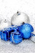 Christmas gifts and decorations on shiny glitter background
