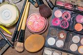 picture of dirty  - Used makeup accessories on tangle dirty table. ** Note: Visible grain at 100%, best at smaller sizes - JPG