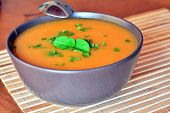 stock photo of butternut  - Creamy Butternut Squash Soup In Ceramic Bowl On The Wooden Table - JPG